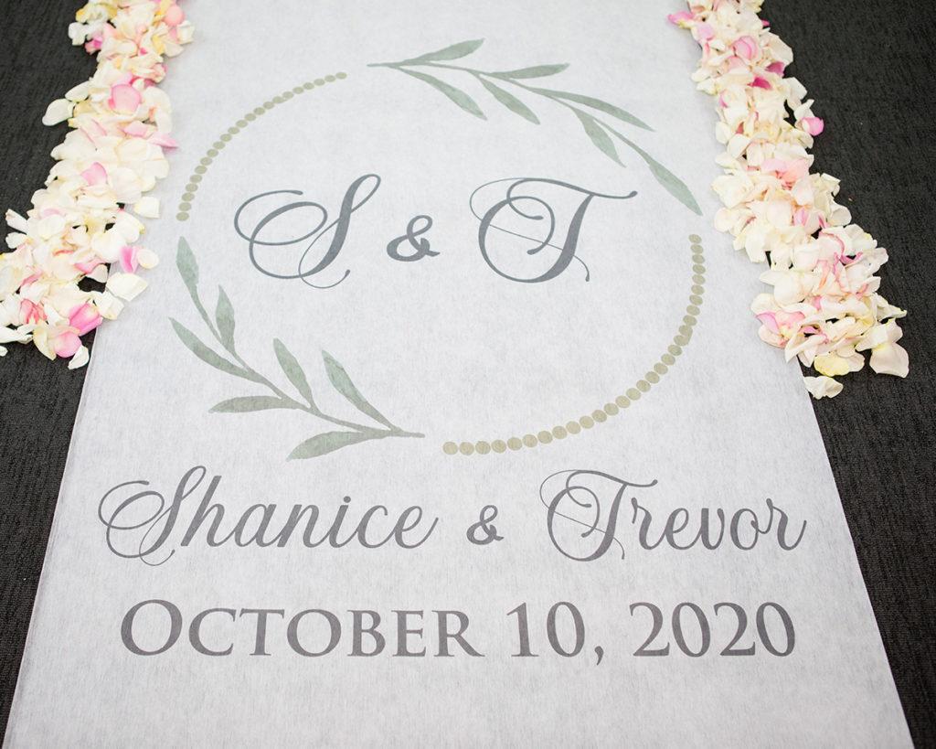 White floor runner for Shanice and Trevor's intimate micro wedding.